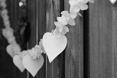 Hearts pendulum at a wedding. It is a black and white photo Royalty Free Stock Photo