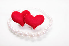 Hearts and perls. Focus on hearts Royalty Free Stock Photos