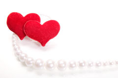 Hearts and perls. Focus on hearts Royalty Free Stock Photo