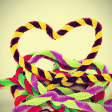Hearts. A pile of hearts of different colors made with pipe cleaners, with a retro effect Royalty Free Stock Image