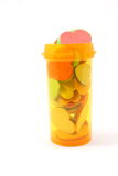 Hearts in a pill container. Heart shapes overfill a pill medicatin container Stock Photos