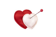Hearts and pin isolated. Hearts pierced with pin isolated on white Royalty Free Stock Photos