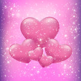 Hearts on a pink background Stock Image