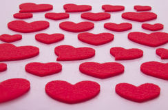 Hearts on a pink background Stock Images