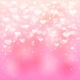 Hearts on pink background Stock Images