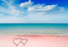 Hearts on a pink beach Royalty Free Stock Image