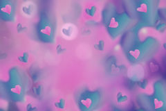 Hearts  pink-blue on blurred pink-violet background bokeh.  Arrangement on Valentine`s Day. Bright collage. Hearts  pink-blue on blurred pink-violet background Royalty Free Stock Photo