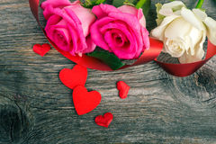 Hearts and pink and white  roses on wooden table Royalty Free Stock Photography