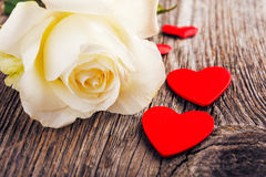 Hearts and pink and white  roses on wooden table Stock Photos