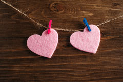 Hearts. Pink hearts on wooden background royalty free stock image