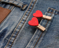 Hearts in pocket jeans Stock Images