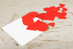 Hearts poured out from the envelope Royalty Free Stock Photo
