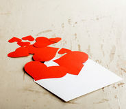 Hearts poured out from the envelope Royalty Free Stock Image