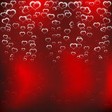Hearts on a red background. Stock Images