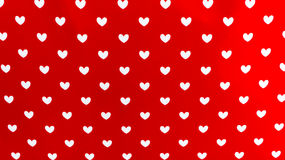 Hearts on the red background Royalty Free Stock Image