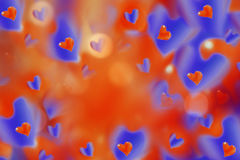Hearts  red-blue on blurred red-orange background bokeh.  Arrangement on Valentine`s Day. Bright collage. Hearts  red-blue on blurred red-orange background Royalty Free Stock Photography