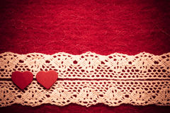 Hearts on red cloth background Stock Images