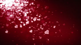 Hearts Red Falling. Hearts float along on a soft current. This is 1 clip in a set of 3. All sets or clips are available in 3 different colors. All clips loop stock video footage