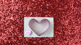 Hearts on Red Glitter Background Stock Photo