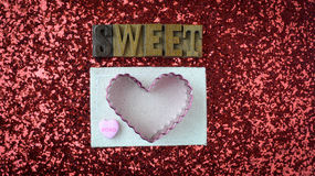 Hearts on Red Glitter Background Stock Photos
