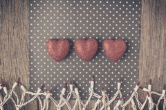 Hearts with red glitter on Polka Dot Background and Holiday Ligh Stock Image
