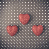 Hearts with red glitter on Polka Dot Background Royalty Free Stock Image