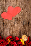 Hearts with red potpourri flower petals on wooden background - Series 2 Stock Image