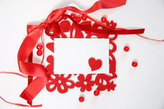 Hearts with red ribbon Stock Images
