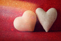 Hearts on red shiny background Stock Image