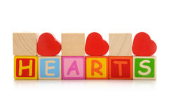 Hearts. Red wooden hearts with letters Royalty Free Stock Images