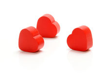 Hearts. Red wooden hearts on white background Royalty Free Stock Images