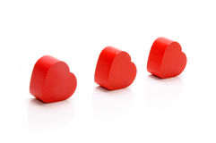 Hearts. Red wooden hearts on white background Royalty Free Stock Photos