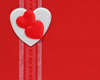 Hearts and ribbon on a red background Stock Photo