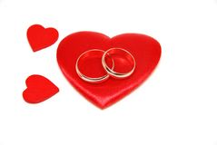 Hearts and rings. Composition golden rings with red hearts Royalty Free Stock Photography