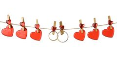 Hearts and rings on a clothesline Stock Images