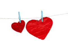 Hearts on a rope isolated on white background Stock Images