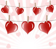 Hearts on rope on sunny background. Royalty Free Stock Photography