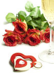 Hearts and roses. Red roses and hearts of red and white felt with a glass of champagne Royalty Free Stock Images