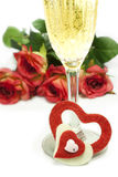 Hearts and roses. Red roses and hearts of red and white felt with a glass of champagne Stock Photo