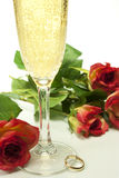 Hearts and roses. Red roses with a glass of champagne Stock Photos