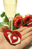 Hearts and roses. Red roses and hearts of red and white felt with a glass of champagne Royalty Free Stock Photos