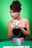 Hearts Royal Flush. Sexy woman at a poker table showing a hearts Royal Flush Royalty Free Stock Images