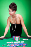 Hearts royal flush. Casino woman standing against poker table near her hearts royal flush Stock Photos