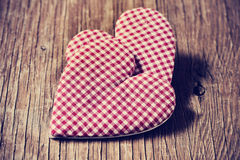 Hearts on a rustic wooden surface Royalty Free Stock Images