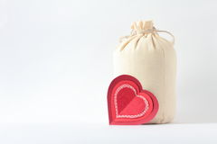 Hearts and sack on white. Background Stock Photos