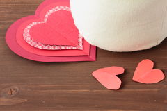 Hearts and sack on wooden. Background Royalty Free Stock Image
