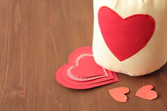 Hearts and sack on wooden. Backround Stock Photography