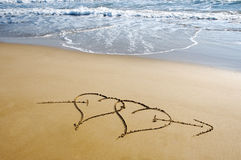 Hearts in the sand. Two ensambled hearts drawn in the sand of a beach Royalty Free Stock Image
