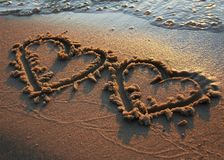 Hearts on sand Royalty Free Stock Photos
