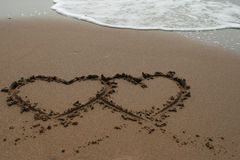 HEARTS IN THE SAND Stock Image